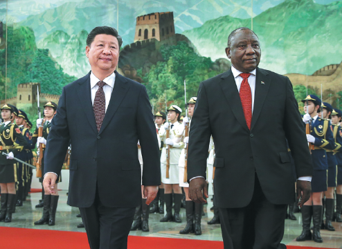 President Xi Jinping accompanies South African President Cyril Ramaphosa in the Great Hall of the People in Beijing on Sunday. (FENG YONGBIN/CHINA DAILY)