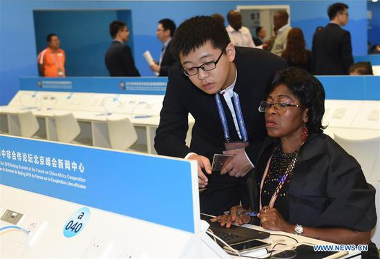 Volunteers provide service at FOCAC media center