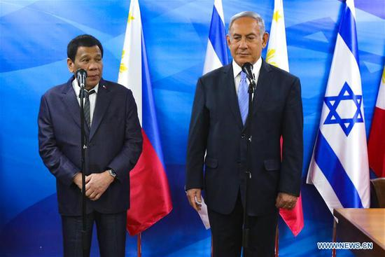 Philippine President Rodrigo Duterte (L) meets with Israeli Prime Minister Benjamin Netanyahu in Jerusalem, on Sep. 3, 2018. Philippine President Rodrigo Duterte received a warm welcome by Israeli Prime Minister Benjamin Netanyahu on Monday, as the Phipilline president started his visit in Israel. (Xinhua/Marc Israel Sellem/POOL/JINI)