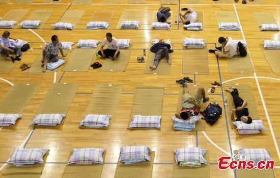 Parents of freshmen students sleep in gym