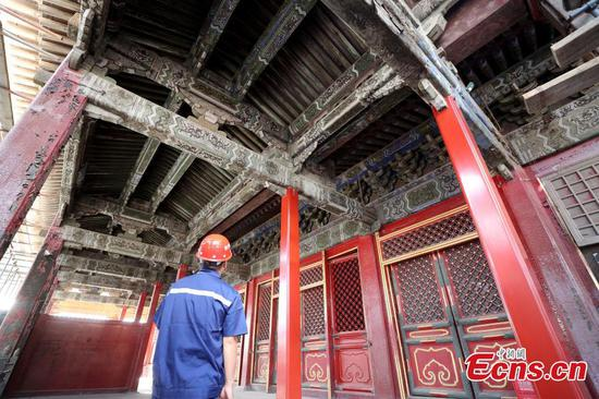 After preparing for two years, the research project into the restoration and conservation of The Hall of Mental Cultivation was launched on September 3, 2018 at the Palace Museum.   (Photo: China News Service/Zhang Yu)