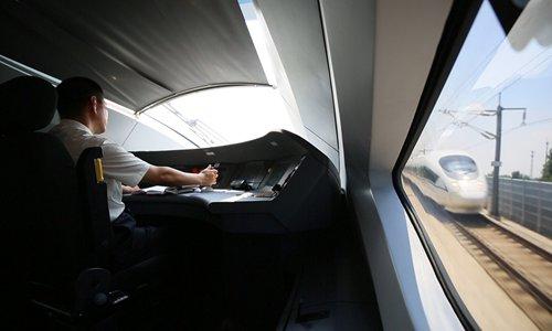 Xue Jun drives a bullet train. (File photo/Courtesy of China Railway Corp)