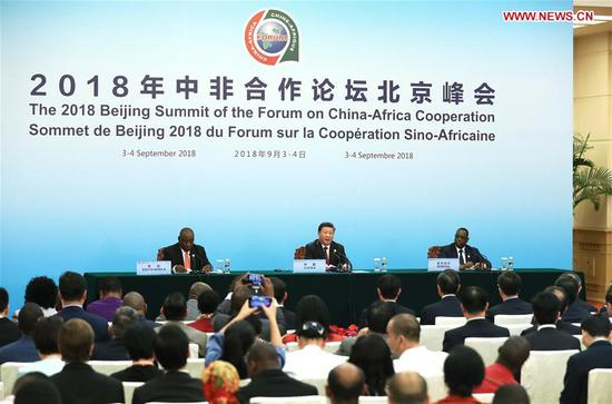 Chinese President Xi Jinping (C, back) meets the press together with South African President Cyril Ramaphosa (L, back) and Senegalese President Macky Sall, former and new African co-chair of the Forum on China-Africa Cooperation (FOCAC), after the conclusion of the 2018 FOCAC Beijing Summit at the Great Hall of the People in Beijing, capital of China, Sept. 4, 2018. (Xinhua/Liu Weibing)