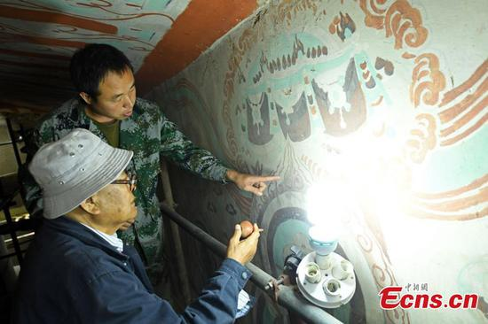 Expert, 80, still devoted to Mogao Caves restoration