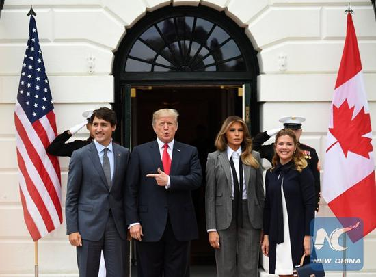 File Photo: U.S. President Donald Trump (2nd L) welcomes visiting Canadian Prime Minister Justin Trudeau (1st L) at the White House in Washington D.C., the United States, on Oct. 11, 2017. Trump met with Trudeau amid new NAFTA negotiations. (Xinhua/Yin Bogu)