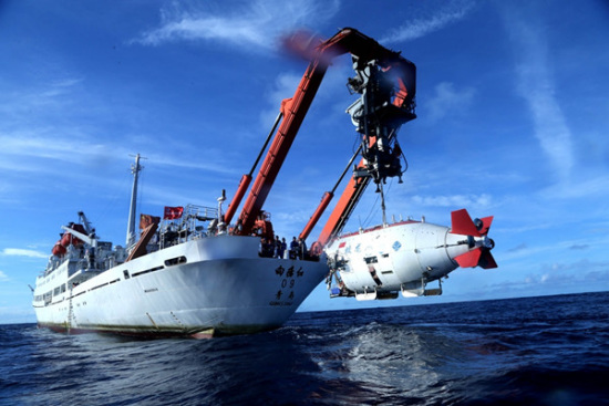 Jiaolong, China's manned submersible, is lowered for a dive on June 20, 2017. (Photo/Xinhua)