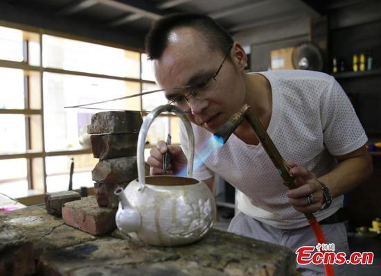 Young silversmith dedicated to inheriting craft