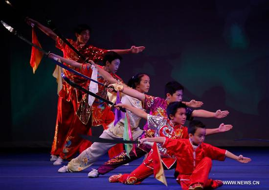 Martial artists show off their Kungfu skills to a large audience for the