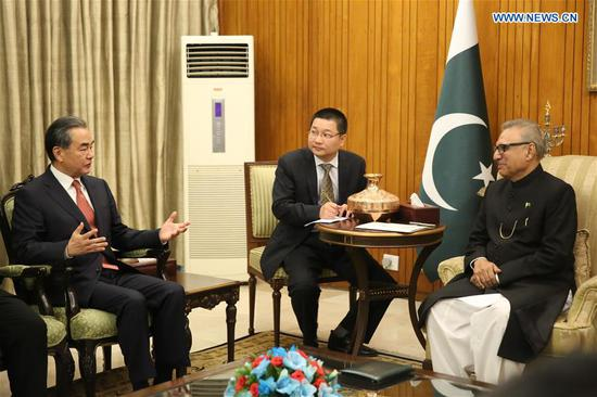 Pakistani President Arif Alvi meets with visiting Chinese State Councilor and Foreign Minister Wang Yi in Islamabad, Pakistan, on Sept. 9, 2018. (Xinhua/Liu Tian)