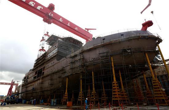 Photo taken on Aug. 14 shows the Xuelong 2 in construction at Jiangnan Shipyard Group in Shanghai. (Photo/Xinhua)