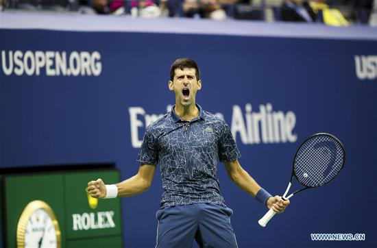 Novak Djokovic of Serbia celebrates scoring during the men's singles final match against Juan Martin del Potro of Argentina at the 2018 US Open tennis tournament in New York, the United States, Sept. 9, 2018. Djokovic claimed the title by defeating Juan Martin del Potro of Argentina with 3-0 in the final. (Xinhua/Wang Ying)