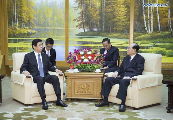 China's top legislator Li Zhanshu (L) meets with Kim Yong Nam, member of the Presidium of the Political Bureau of the Central Committee of the Workers' Party of Korea (WPK) and president of the Presidium of the Supreme People's Assembly of the Democratic People's Republic of Korea (DPRK), in the DPRK, on Sept. 8, 2018.  (Xinhua/Li Tao)