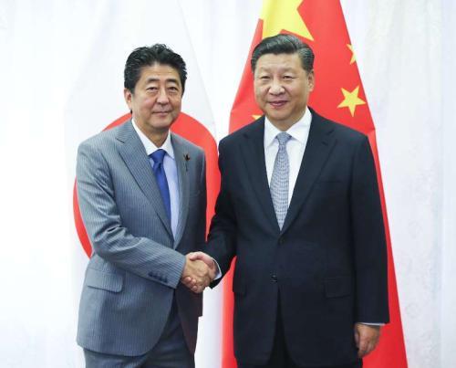 Chinese President Xi Jinping and Japanese Prime Minister Shinzo Abe meet in Vladivostokon, Sept. 12, 2018. (Photo/Xinhua)