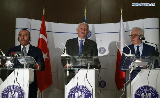 Turkish Foreign Minister Mevlut Cavusoglu (L), Polish Foreign Minister Jacek Czaputowicz (R), and Romanian Foreign Minister Teodor Melescanu attend a press conference in Bucharest, Romania, on Sept. 11, 2018. Visiting Polish Foreign Minister Jacek Czaputowicz on Tuesday accused some European officials of using