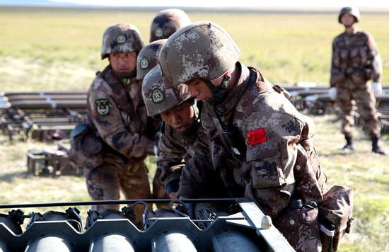 Soldiers from the People's Liberation Army's Northern Theater Command prepare on Friday for the military drill