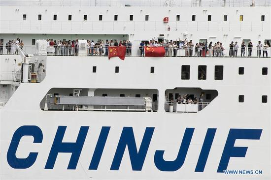 Ferry with Chinese passengers stranded by typhoon leaves for Shanghai