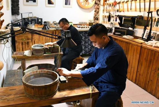 Father and son dedicated to ancient weapon restoration
