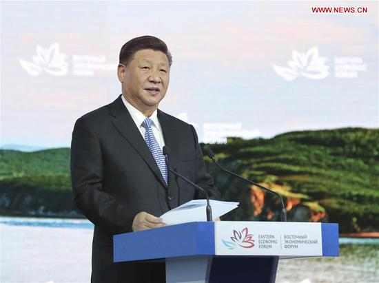 Chinese President Xi Jinping addresses the plenary session of the fourth Eastern Economic Forum (EEF) held in Vladivostok in Russia's Far East, on Sept. 12, 2018. (Xinhua/Ju Peng)