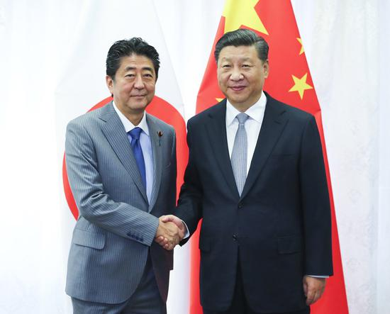 President Xi Jinping meets with Japanese Prime Minister Shinzo Abe on the sidelines of the fourth Eastern Economic Forum in Vladivostok, Russia, on Sept. 12, 2018. (Photo/Xinhua)