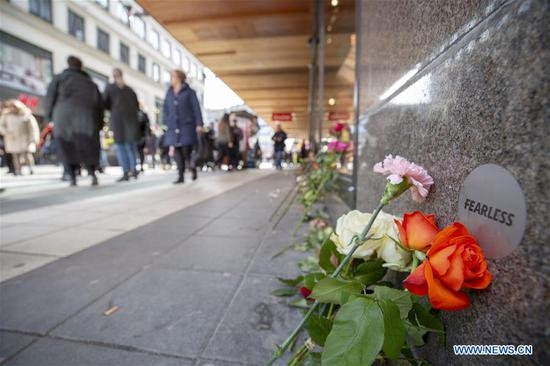 Flowers are laid in memory of the victims of last year's truck attack, in Stockholm, Sweden, on April 7, 2018. (Photo/Xinhua)