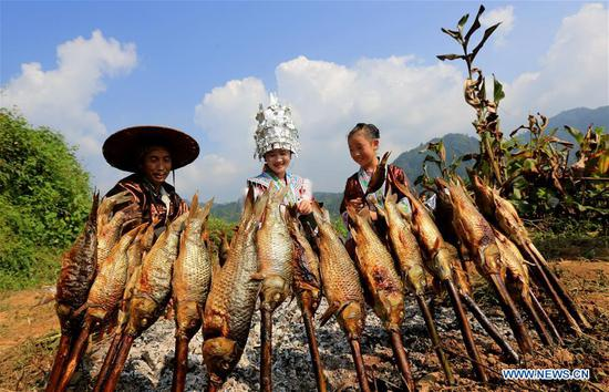 Miao ethnic group celebrate harvest in Guangxi
