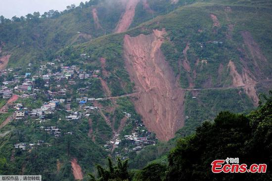 Dozens buried in landslides in Philippines after tropical storm
