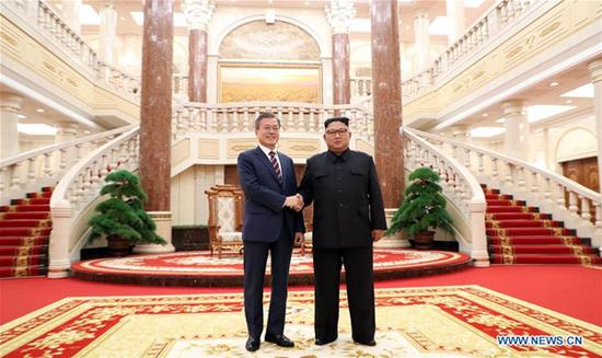 Kim Jong Un (R), top leader of the Democratic People's Republic of Korea (DPRK), meets with visiting South Korean President Moon Jae-in in Pyongyang, DPRK, in the third summit for the pair this year, on Sept. 18, 2018. (Xinhua/Pyongyang Press Corps)
