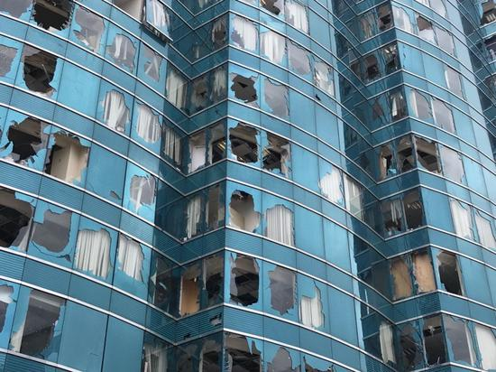 Windows of an office building were battered by the typhoon. /CGTN Photo