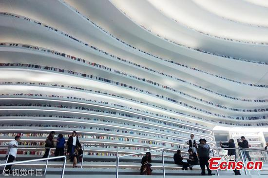 The roof and walls of the Binhai New Area library is pictured on Oct 2, 2017. As the flowing design resembles sea waves, many internet users commented,