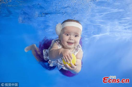 Cute baby swims underwater in Ukraine