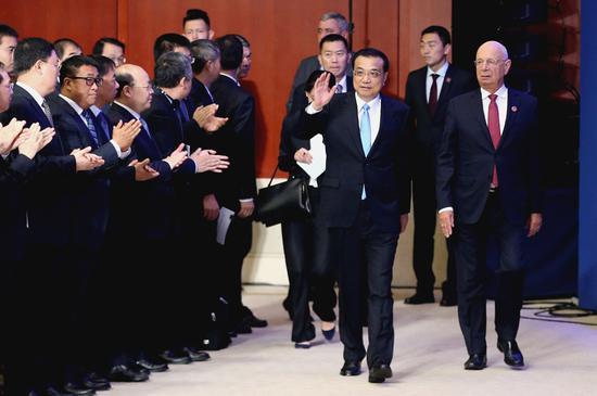 Li backs free trade at Summer Davos