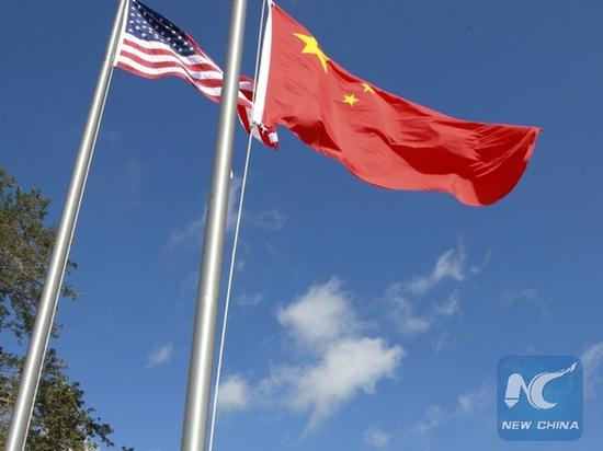 China vows to retaliate over U.S. actions against Chinese media, journalists