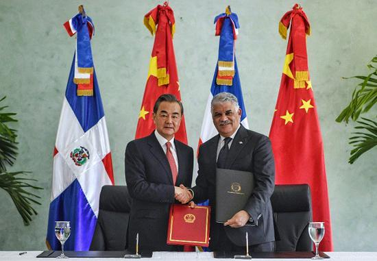 The relationship between China and the Dominican Republic has opened a new page and ushered in a broad and bright future, said visiting Chinese State Councilor and Foreign Minister Wang Yi here on Friday. (Photo/Xinhua)