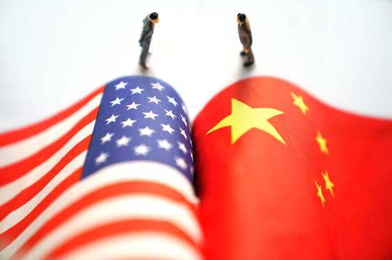 China stresses dialogue on trade but rejects U.S. 'bullyism'