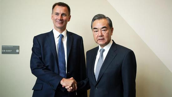 China, Britain agree to defend int'l system, multilateralism