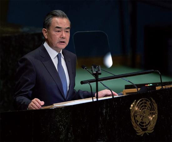 Chinese State Councilor and Foreign Minister Wang Yi addresses the Nelson Mandela Peace Summit on Monday at the United Nations. (Photo/China News service)