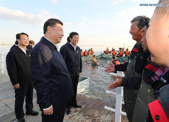 Chinese President Xi Jinping, also general secretary of the Communist Party of China (CPC) Central Committee and chairman of the Central Military Commission, talks with fishermen as he visits the Chagan Lake in Songyuan, northeast China's Jilin Province, Sept. 26, 2018. (Xinhua/Ju Peng)