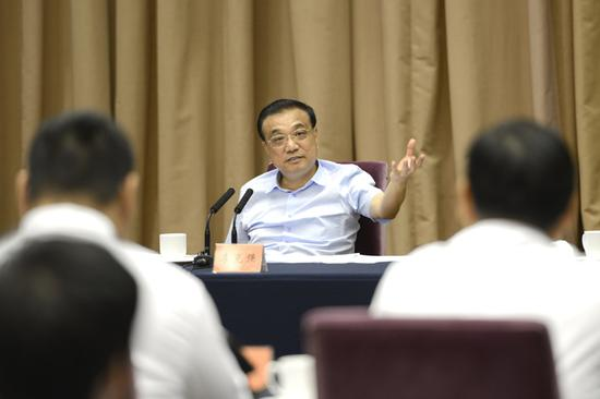 Premier Li Keqiang speaks at a symposium with entrepreneurs in Zhejiang on Sept. 28, 2018. (Photo/gov.cn)