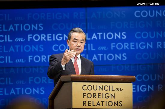 Chinese State Councilor and Foreign Minister Wang Yi delivers a speech titled