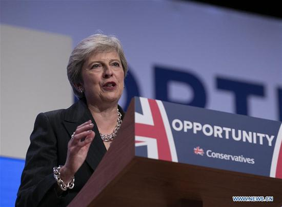 Britain's Prime Minister Theresa May gives a speech during the Conservative Party annual conference 2018 in Birmingham, Britain on Oct. 3, 2018. British Prime Minister Theresa May on Wednesday ruled out the possibility of a second Brexit referendum, saying the second referendum would be a