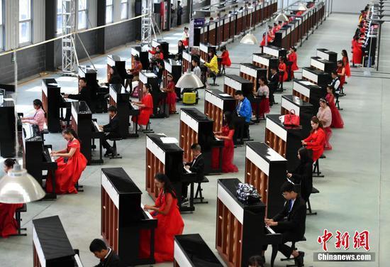 Piano event creates new Guinness World Record