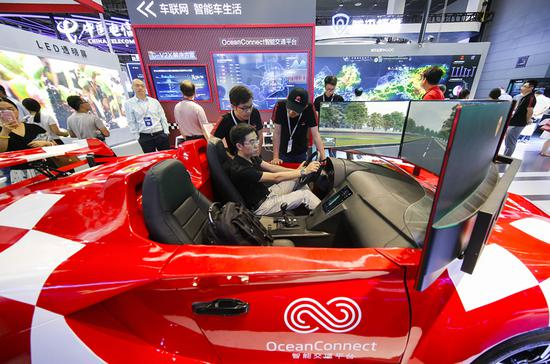 A futuristic concept car at the 2018 World Internet of Things Expo in Wuxi, Jiangsu province, last month is equipped with Internet of Vehicles technology, which collects and analyzes traffic and driving data. (CHENG JIABEI/FOR CHINA DAILY)