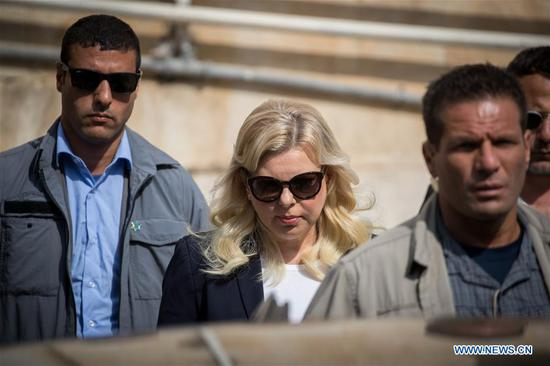 Sara Netanyahu (C), wife of Israeli Prime Minister Benjamin Netanyahu, arrives for a court hearing at the Magistrate's Court in Jerusalem, on Oct. 7, 2018. Sara Netanyahu went on trial on Sunday for alleged crimes including fraud over misuse of public funds to pay for hundreds of gourmet meals. (Xinhua/JINI)