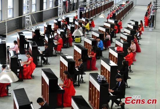 666 pianos set Guinness World Record