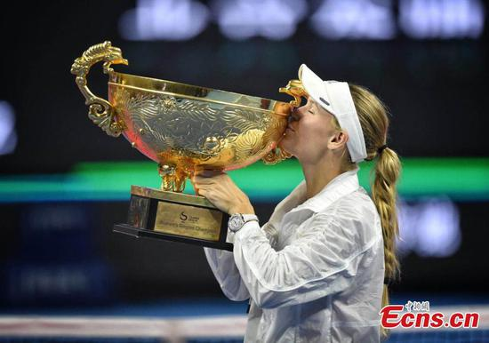 Wozniacki swats aside Sevastova to wear Beijing crown