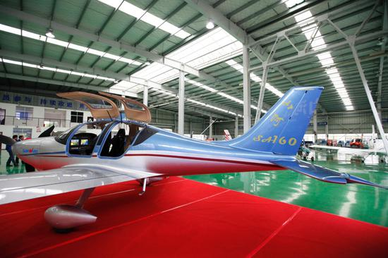 China's first all-composite aircraft completes first flight