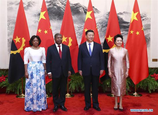 Chinese President Xi Jinping and his wife Peng Liyuan pose for a group photo with Angolan President Joao Lourenco and his wife in Beijing, capital of China, Oct. 9, 2018. Xi held talks with Joao Lourenco in Beijing on Tuesday. (Xinhua/Xie Huanchi)
