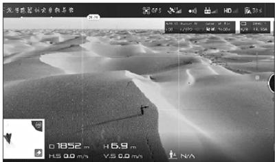 The camera footage of a drone shows a man who got lost in Taklamakan Desert. (Photo provided by Qiemo County police office)
