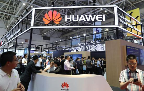 The booth of Huawei at a digital products exhibition in Fuzhou, Fujian province, on April 23. (Photo by Zhu Xingxin/China Daily)