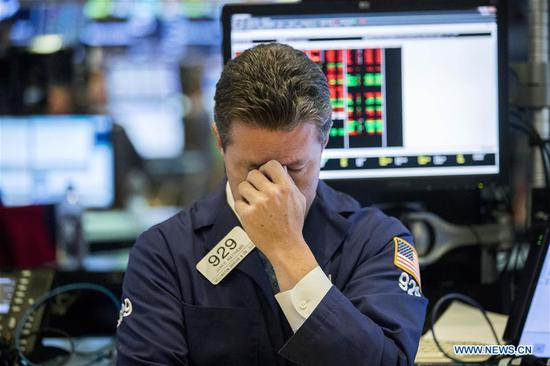 A trader reacts at the New York Stock Exchange in New York, the United States, on Oct. 11, 2018. U.S. stocks extended deep losses in volatile trading on Thursday.  (Xinhua/Wang Ying)